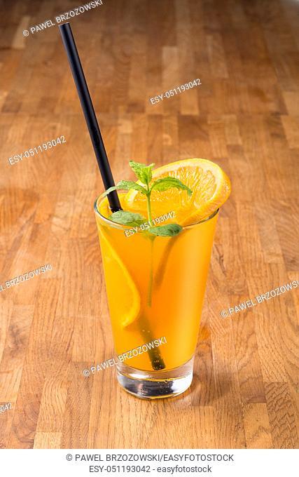 Orange drink on wooden background. For fast food restaurant design or fast food menu