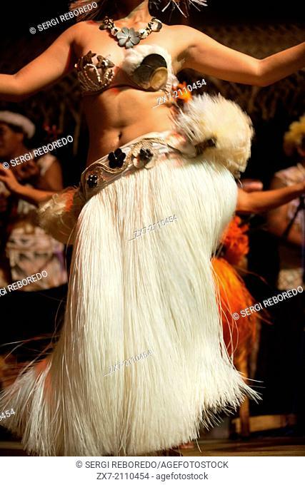 Rarotonga Island. Cook Island. Polynesia. South Pacific Ocean. A woman dances moving her hips in one of the traditional dances of the Cook Island