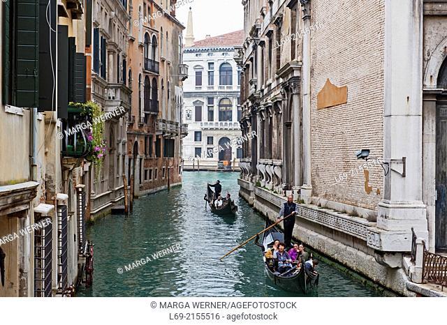 Gondola in a canal, Sestiere San Marco, Canal Grande in background, Venice, Veneto, Italy