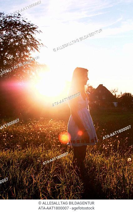 Young girl watching the sundown