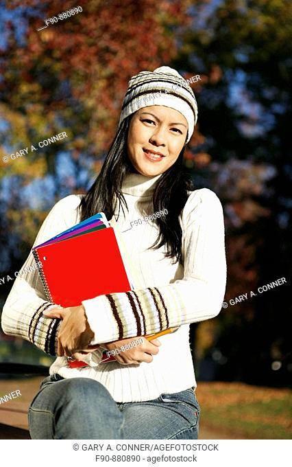 Graduate student w autumn leaves MR