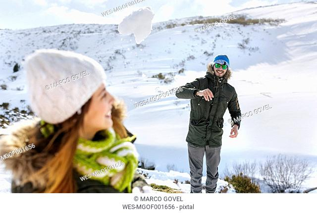 Spain, Asturias, couple playing in the snow