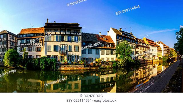 Old center of Strasbourg. Typical alsacien houses on the river. Vivid colors on sunset. Touristic concept