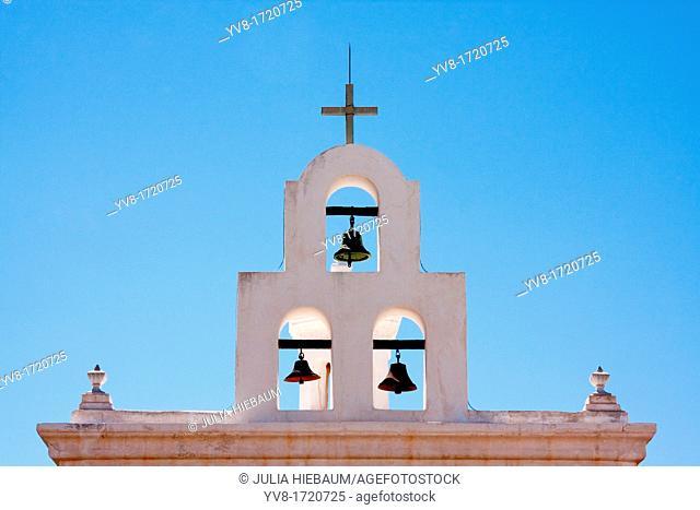 Three church bells adjacent to San Xavier's mission in Tucson, Arizona