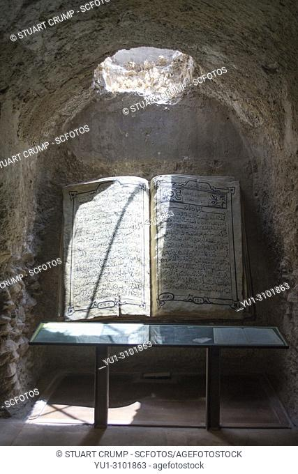 The Koran on display in the Interior of the Large Cistern at Lorca Castle in Murcia Spain