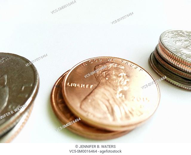Close-up of U.S. coins on a red background