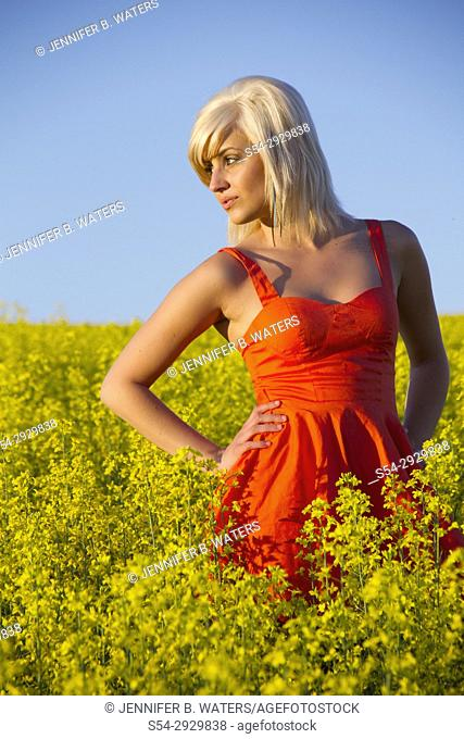 A young woman outdoors in a canola field, Spokane County, Washington, USA