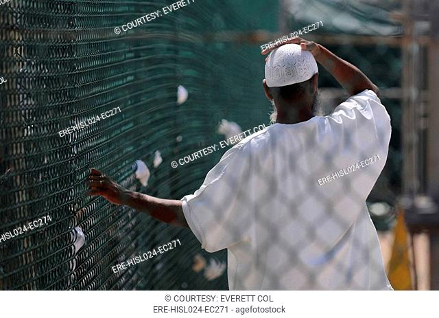 In Camp Delta prison at Guantanamo Bay Naval Base Cuba a detainee stands in the recreation yard. June 8 2010., Photo by:Everett CollectionBSLOC-2011-6-143
