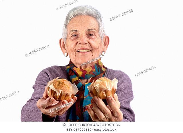 senior woman eating cupcake. on white background