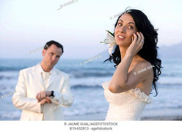 Newly married couple on the beach