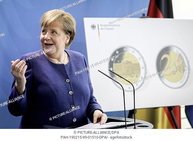 "15 February 2019, Berlin: Chancellor Angela Merkel (CDU) presents the new two-euro commemorative coin with the motif of the """"Bundesrat"""""