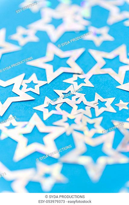 star shaped confetti decoration on blue background