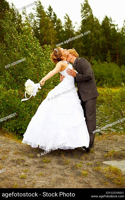 Groom passionately kisses bride