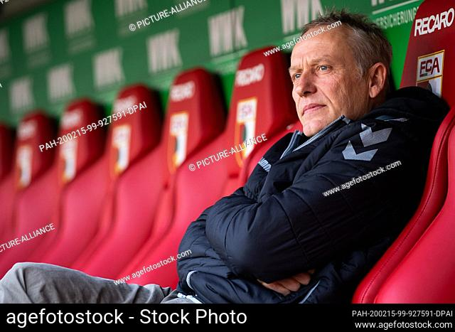 15 February 2020, Bavaria, Augsburg: Football: Bundesliga, 22nd matchday, FC Augsburg - SC Freiburg, WWK Arena. Freiburg's coach Christian Streich sits on the...