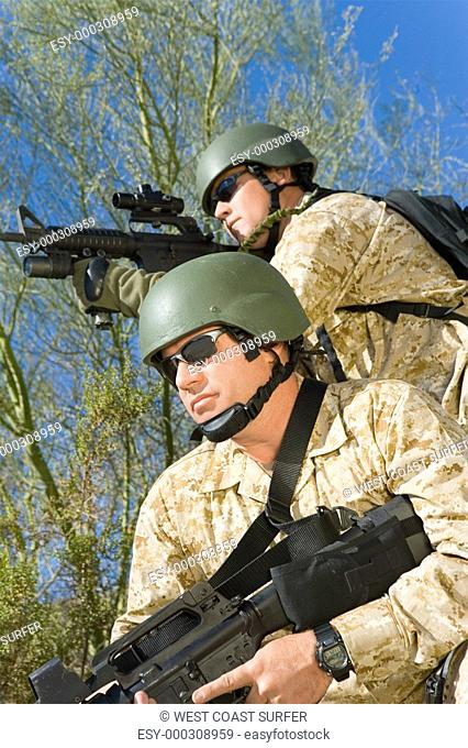 Two soldiers on patrol outdoors