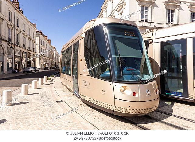 Two trams pass in rue Jeanne d'Arc in orleans, France