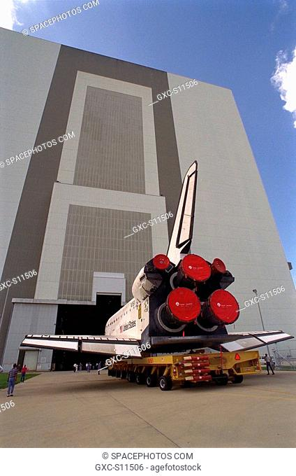 07/07/1997 --- The Space Shuttle Orbiter Discovery rolls over from Orbiter Processing Facility 2 on top of the orbiter transporter to the Vehicle Assembly...