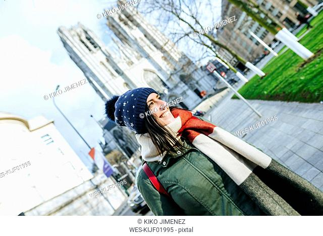 Belgium, Brussels, woman with winter clothes in front of Brussels Cathedral