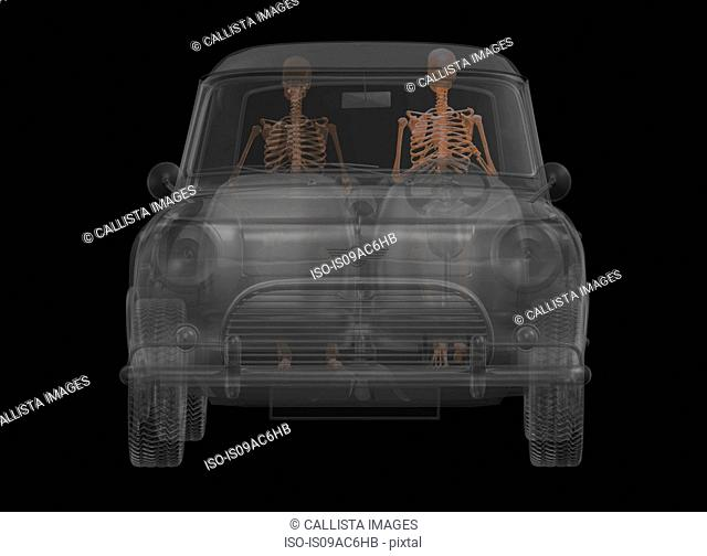 Automobile with driver and passenger as skeletons