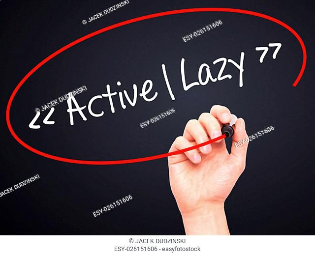 Man Hand writing Active - Lazy with black marker on visual screen. Isolated on background. Business, technology, internet concept. Stock Photo