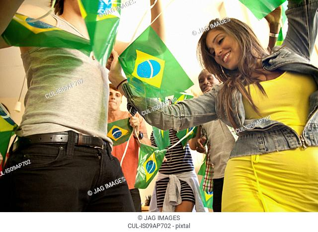 Students celebrating with Brazilian flags
