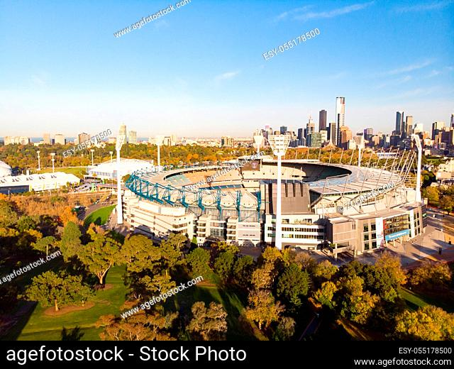 Melbourne's famous skyline with Melbourne Cricket Ground stadium in the foreground on a cool autumn morning in Melbourne, Victoria, Australia