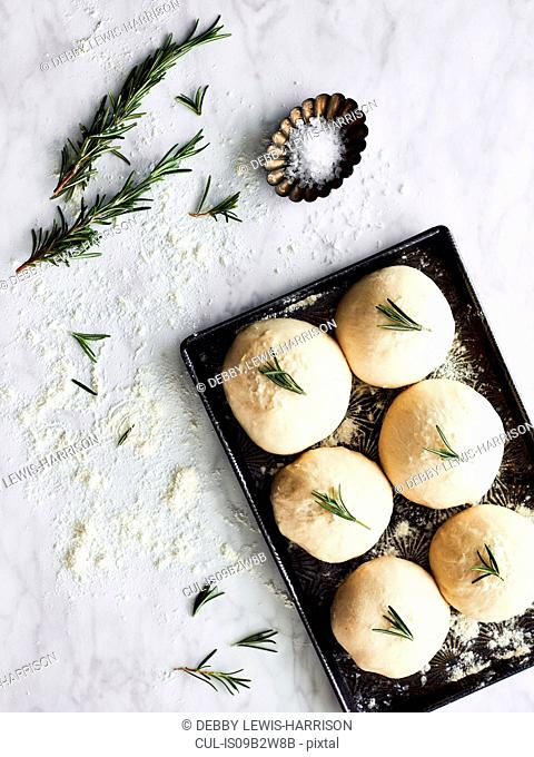 Uncooked rolls on baking tray