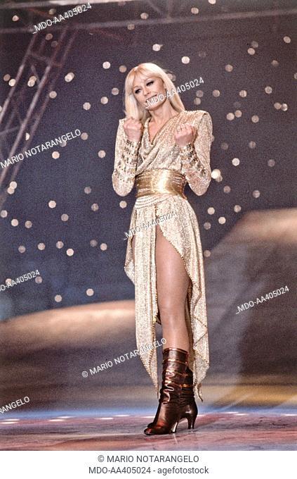 Raffaella Carrà wearing a golden dress in Buonasera Raffaella. Italian TV presenter, actress, singer and showgirl Raffaella Carrà (Raffaella Maria Roberta...
