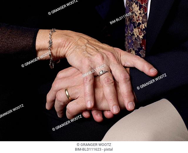 Close up of older couple's clasped hands