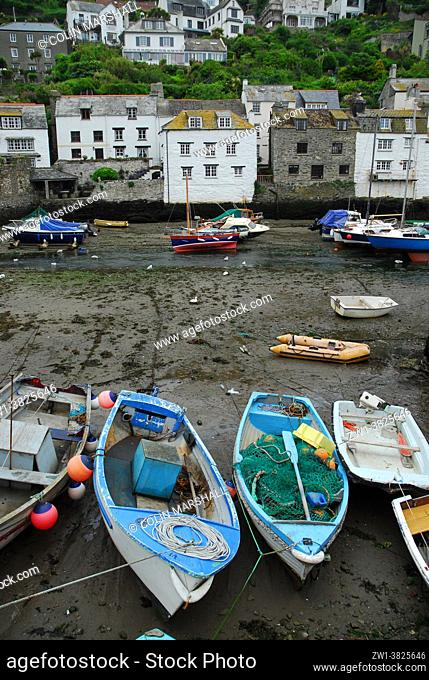 Boats on River Pol at low tide, Polperro village, Cornwall , United Kingdom
