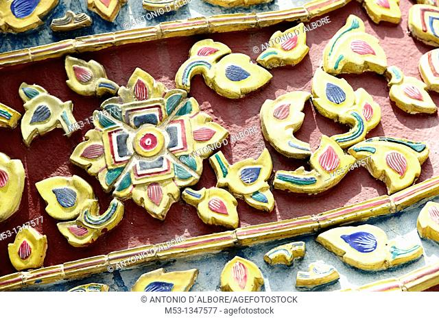 Detail of ceramic tiles on a building in the complex of the Grand Palace Phra Borom Maha Ratcha Wang in bangkok  thailand