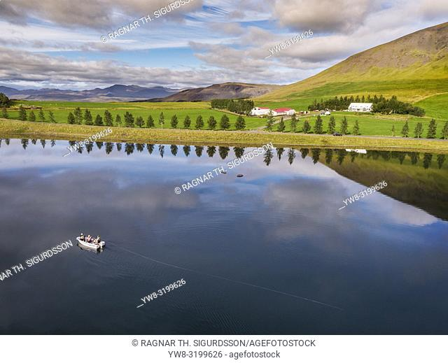 Boating on Lake Medalfellsvatn, Iceland. This image is shot using a drone