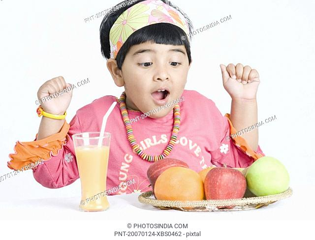 Girl looking at fruits and surprised