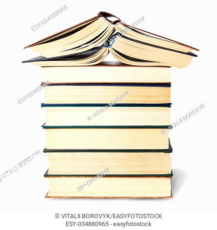 Stack of six old books with two open top isolated on white background