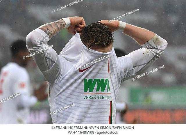 Andre HAHN (FC Augsburg) takes off his jersey after the end of the game, action, single shot, single motif, half figure, half figure