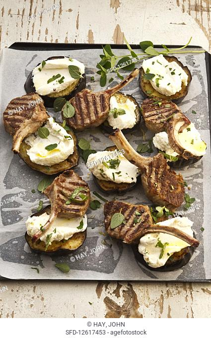 Lamb cutlets on eggplant with hommus and creamy goats cheese