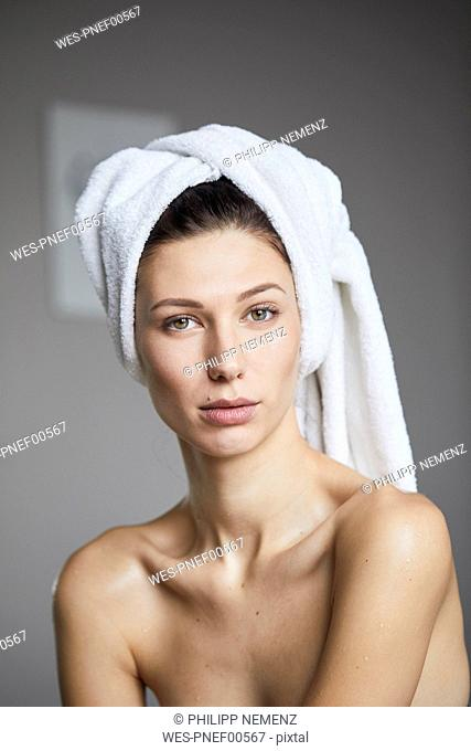 Portrait of young woman with towel around her head