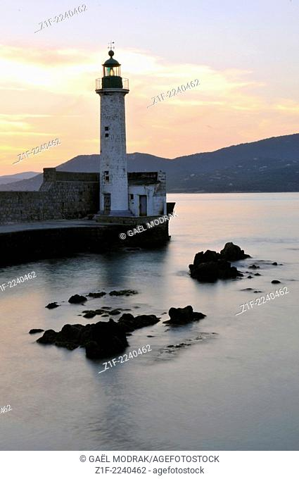 Propriano's lighthouse at sunset, Corsica, France