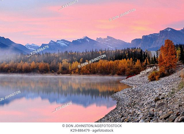 Abraham Lake in autumn with dawn sky reflections