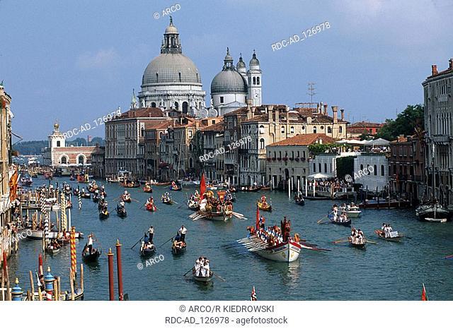 Historical regatta  'Regatta Storica' gondolas on Grand Canal and Church Santa Maria della Salute Venice Italy