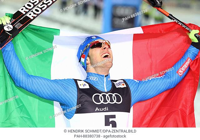 Italian athlete Federico Pellegrino celebrates after his triumph in the freestyle cross country skiing event at the 2017 Nordic World Ski Championships in Lahti