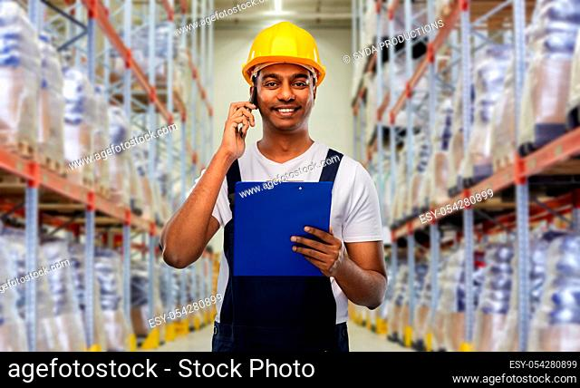 indian worker calling on smartphone at warehouse