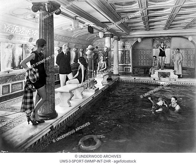 Italy: c. 1927.Passengers lounging around the Pompeian indoor pool on the Italian passenger liner MS Vulcania