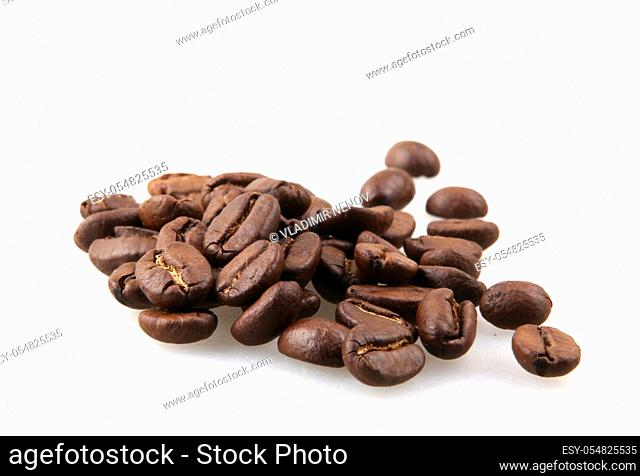 Coffee beans isolated on white background. A coffee bean is a seed of the Coffea plant and the source for coffee