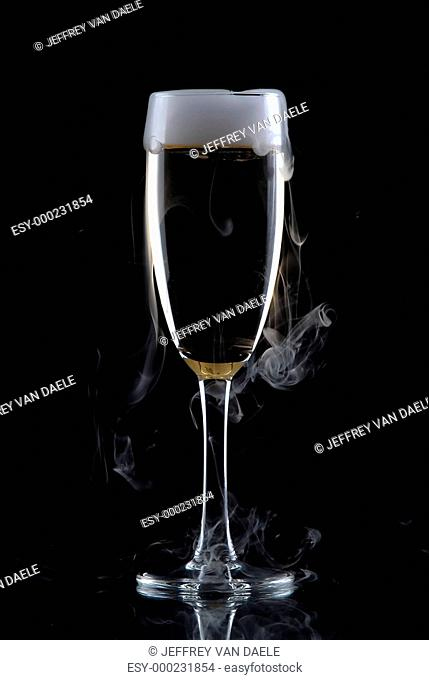 Glass of wine isolated over black background