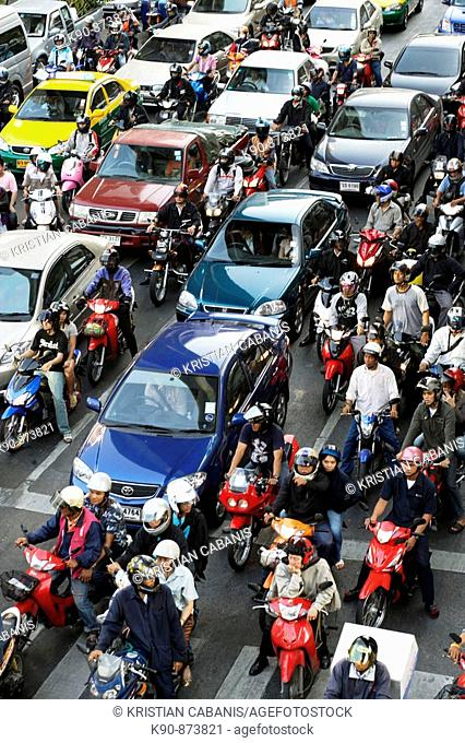 Traffic jam - cars and motorcycle waiting closely at a red light on Rhatjadamri Road in the centre of Bangkok, Thailand, Southeast Asia