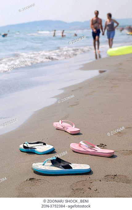 sandals pair on beach
