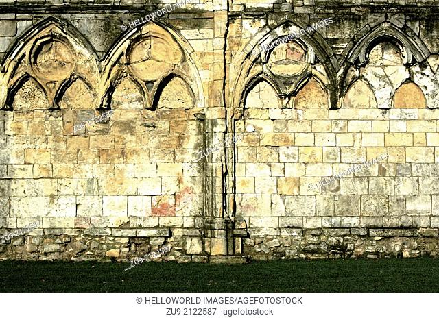 Textured stone wall of grade 1 listed Benedictine ruin, St Mary's Abbey, York, North Yorkshire, England, Europe