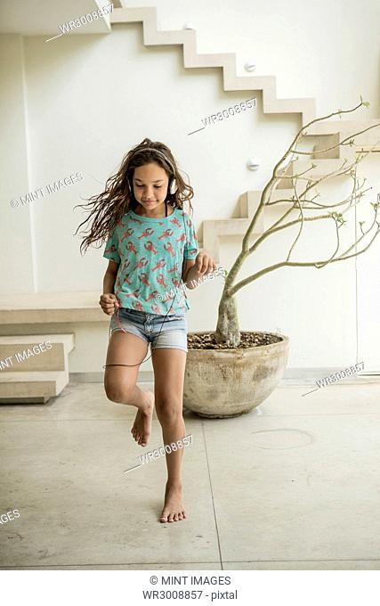 A girl running in a house