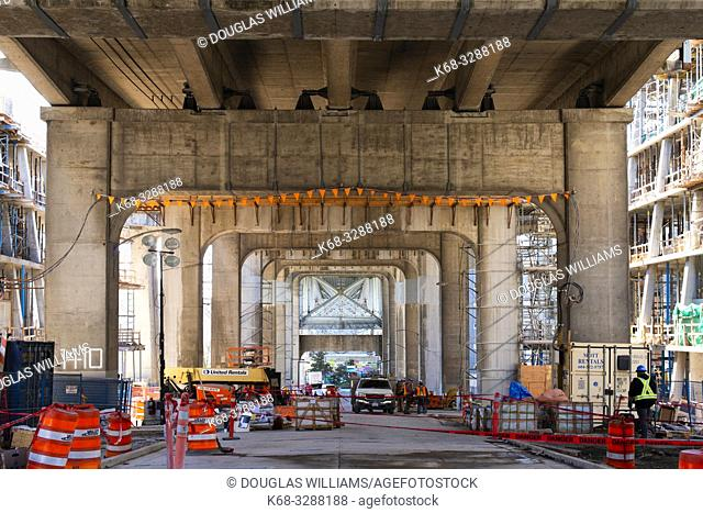 Construction under the Granville Street Bridge on Vancouver House, a new tower in downtown Vancouver, BC, Canada, designed by BIG